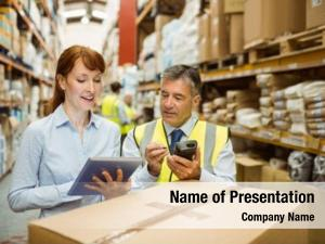 Managers close warehouse looking tablet