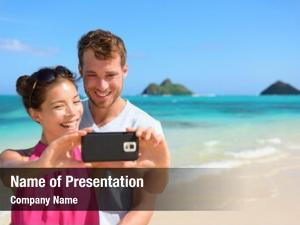 Couple beach vacation taking selfie