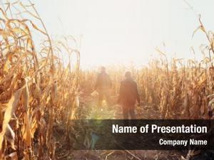 Walking father son dried corn