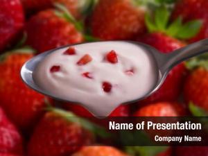 Yogurt strawberry pieces cream spoon