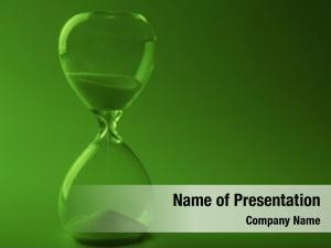 Hourglass on green