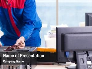 Specialist computer repairman repairing computer