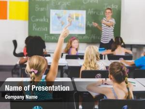 Raising school girl hand classroom