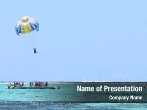 Indian parasailing over ocean near