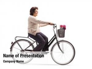 Riding mature woman bicycle white
