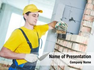 Laying construction worker bricks wall