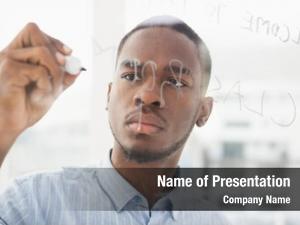 Writing focused businessman clear board