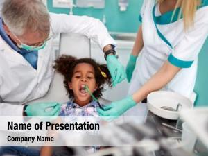 Assistant female dental putting dental