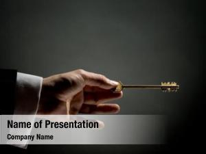 Gold man pointing key