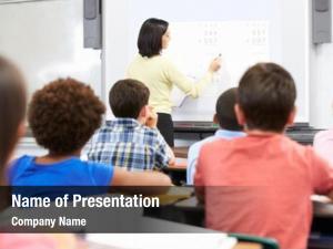 Class teacher standing using interactive
