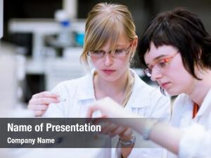 Researchers/chemistry two female students doing