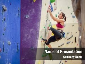 Climbing athlete girl purple wall