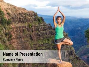 Yoga woman doing hawaii mountains