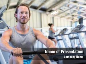 Training fitness man rowing machine