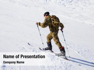 Lifeguard alpine skiing walks slopes