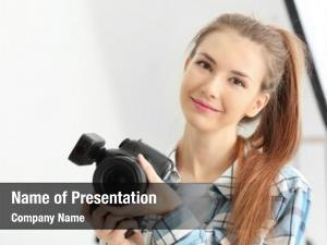 Photographer young female working studio