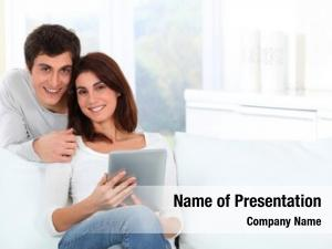 Using young couple electronic tab