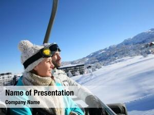 Ski couple sitting resort chairlift