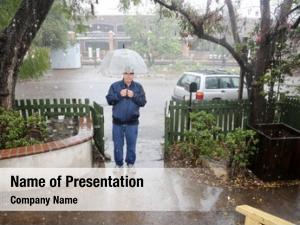 Raining cats and dogs business man stands