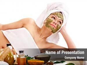 Getting young woman facial mask