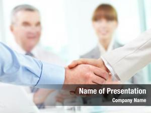 Business photo handshake partners two