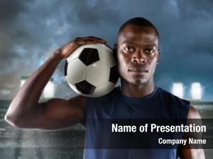 Footballer african american holding ball
