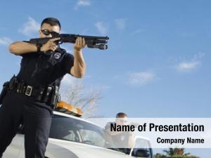 Aiming police officer gun car