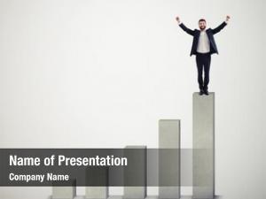 Winner happy businessman standing top
