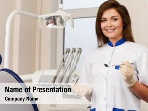Woman young brunette dentist dental