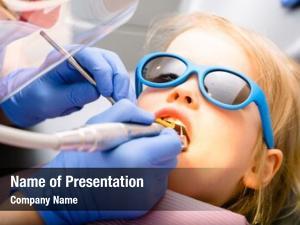 Dental dentist performing filling procedure
