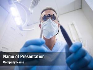 Dental assistant holding