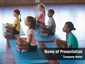 Meditating school kids during yoga
