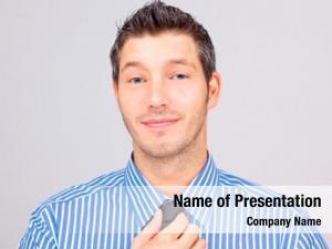 Expressing smiling positive businessman putting