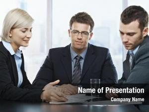 Businessmeeting, mid adult professionals looking documents