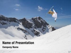 Jumping ski rider snowy mountains