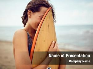 Woman smiling surfer posing her