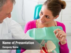 Teeth dentist explaining brushing patient