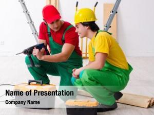 Contractors two workers working indoors