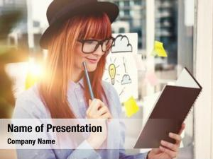 Woman smiling hipster writing notes