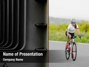 Cyclist young woman riding road