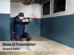 Aiming police woman her gun