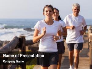 Family happy healthy jogging beach
