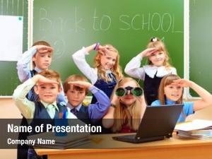 Classroom happy schoolchildren looking through