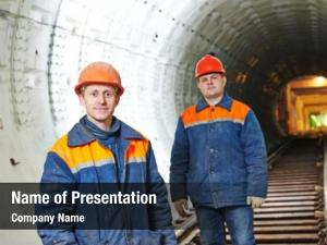 Workers two tunnel mounters underground