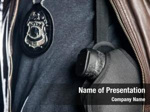 Officer closeup police badge gun