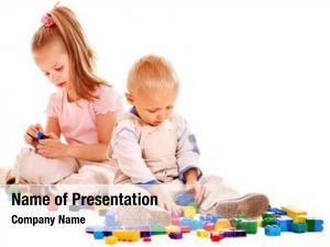 Playing happy children building blocks