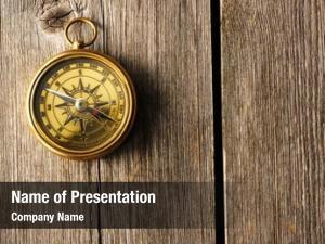 Compass antique brass over wooden