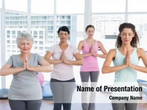 Class female trainer standing namaste