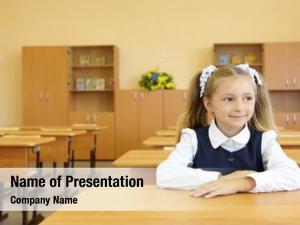 School little girl uniform sits