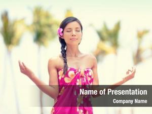 Hawaiian woman meditating palm beach